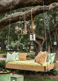 10 Lounge Areas That Will Totally Make Your Wedding: #10. For a whimsical take on the lounge concept consider a fabulous daybed hanging from the trees!