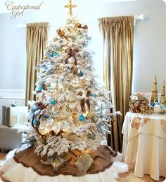 Gorgeous! brown/gold and blue on flocked tree :)