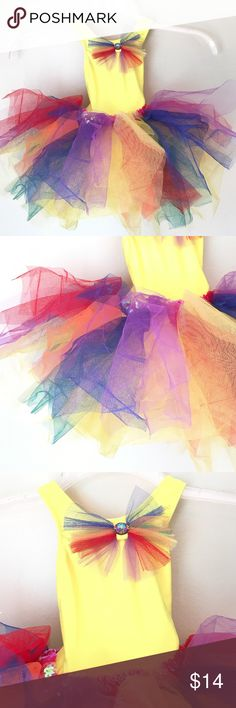 Ballerina Dress Great condition 16in long leotard  8 in chest stretches to 9 in sparkling multi color ruffles bow with rhinestone on front sequence on waist very sweet and fun great for costume or dress up Costumes Dance