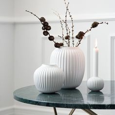 Leave the white Hammershøi vase on its own as a unique design statement or let it form part of an elegant design tableau.