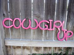 Recycled Horseshoe Cowgirl Up Sign- Pink. $45.00, via Etsy.