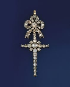 A late 18th century diamond pendant   Modelled as a cross with ribbon bow surmount, set throughout with graduated foiled table-cut diamonds