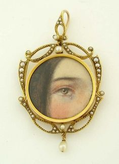 """amorous-nightmares:  """"Eye miniature with tear - Edwardian Circa early 1900s - Lovely woman's eye miniature painted on card and set in a 14K frame inset with seed pearls"""""""