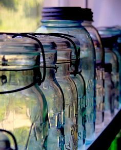 Mason jars - they are wonderful for so many things, from vases to cotton ball and q-tip holders to just stand alone like these in a line for us to admire. Mason Jars, Canning Jars, Bottles And Jars, Glass Bottles, What's My Favorite Color, Ball Jars, Foto Art, Still Life Photography, Colour Photography