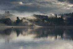 Fishermen on Loch Ard, Trossachs, Scotland.   Picture: Paul Bundle