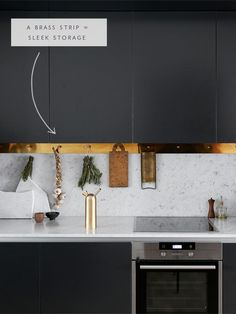 a brass strip with pegs creates the coolest hanging storage weve ever seen - coco kelley \ Kitchen Interior Design \ Home Decor in the the details Brass Kitchen, New Kitchen, Kitchen Dining, Kitchen Decor, Kitchen Worktops, Minimal Kitchen, Kitchen Black, Home Design, Interior Design