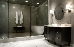 Marble Floors With Colored Shower - Classic white marble floors allow the colored shower to pop