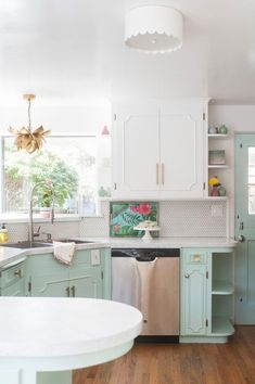 two-tone kitchen cabinets, statement-making light fixtures
