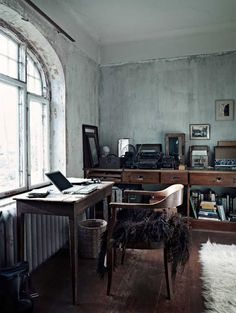 I love the tables, the chair, the pelt, the old typewriters, the window... I don't like the walls and I want more color, but boys, this is great...