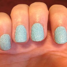 Caviar nails. Don't buy the $25 kit from Sephora for only one color! Go to your local craft store and buy Martha Stewarts microbeads (comes with 12 colors) and buy a matching nail polish and a mega-shine top coat to get this look. Super easy and stays on DAYS longer than the Sephora kit.