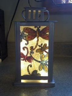 TinkerLytesDragonfly Lantern by TinkerLytes on Etsy, $30.00.....would look beautiful in your garden!