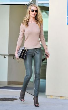 Rosie Huntington-Whiteley layers a cozy beige sweater over luxe Victoria Beckham leather pants