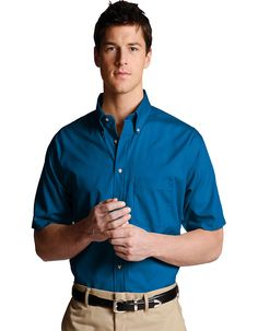 Men's Easy care poplin short sleeve shirt is soft, colorful and hardworking. This performance poplin stands up to demanding wear,button down collar with wood tone buttons, one pocket on the left chest and a back box pleat. This easy care men's shirt features moisture wicking material and is wrinkle resistant with soil release.