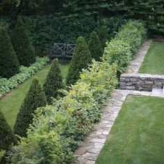 A secret garden below the play lawn, of this Greenwich, CT property, runs perpendicular to the house and is surrounded by a deciduous wall…