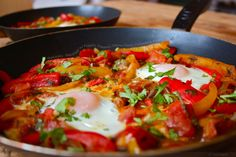 Shakshuka – Baked Eggs with Peppers, Tomatoes, Onions, Cumin, Coriander and Parsley