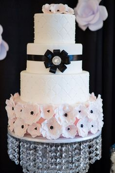 Coco Chanel themed black and pink wedding cake