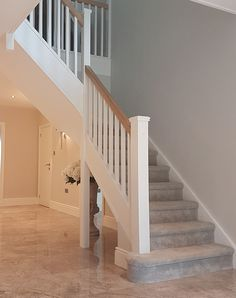 A single winder staircase manufactured in softwood. Our customer chose to paint all visible parts white to create a contrast against the Oak handrail. Tiled Staircase, Painted Staircases, White Staircase, Staircase Handrail, Oak Stairs, Staircase Remodel, Wooden Stairs, House Stairs, Staircase Design