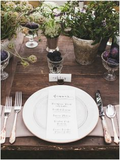 vintage goblets and tiny glass among fuller pieces for an eclectic, one of a kind feel on every table