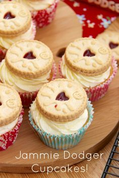 Jammie Dodger Cupcakes!! Delicious Vanilla & Jammy Cupcakes, topped with a Luscious Frosting, and a Jammie Dodger of course!