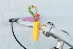 Colleen Jordan's Easter egg-hued vases are the perfect springtime accessory. Built in miniature, her creations are sized to carry small succulents or pocket-sized flower arrangements on one's neckline, lapel, finger, or bicycle handle. The Atlanta-based designer and artist recently made Wearable Pla
