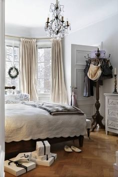 creamy curtains, white-color wall, white matelasse, mix of dark and light furniture...and check it out, coat rack for purses