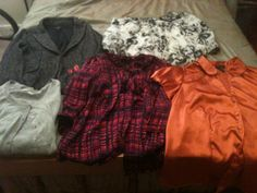My thrift finds today at the Goodwill Outlet/Clearance Center - three blouses, carnigan and Ann Taylor jacket and the red dots you see are earrings for $5.51
