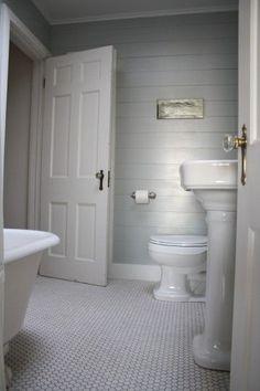 First floor bathroom. Horizontal planking, penny tile floor ...