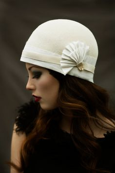The Tennis Pleat Cloche Hat  Ivory by MaggieMowbrayHats on Etsy, £120.00 Very smart, I like a lot.