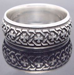 Medieval style sterling silver band.