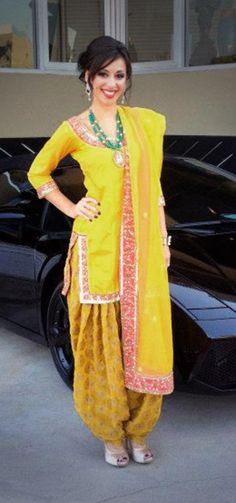 Sensual Yellow brocade Party Wear Churidar Kameez