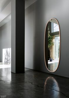 Buy online La plus belle By flos, oval wall-mounted mirror with integrated lighting design Philippe Starck