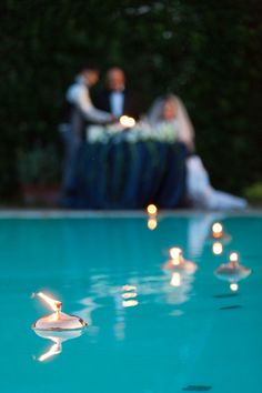 floating candles. Pool or pond. Cute idea for summer evening ...