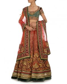 This traditional bridal lehenga in shaded silk velvet with gota, dori and zardozi embroidery, accentuated with mirror work border and crystals. Comes with an em