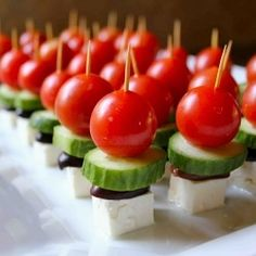 Bite Sized Greek Salad!  3 to 4 Persian cucumbers sliced   1 1/2 pints cherry tomatoes (buy smaller ones)  1 cup pitted Kalamata olives (halved)  1 block of feta (cubed)  1 tablespoon fresh lemon  2 tablespoons olive oil  3/4 teaspoon oregano  fresh pepper  toothpicks