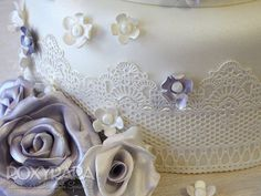 www.RoxyRara.com  Close up of the handmade edible lace and sugar flowers on last summers four tier vintage birdcage cake.   To book in for a wedding cake tasting and consultation, email: cake@roxyrara.com