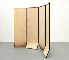 """Design and production of a custom made folding screen for the fourth edition of the exhibition """"Cabinet de curiosités"""" curated by Thomas Erber for Maison Kitsuné NYC materials: structure: drawn steel section 10×10 mm matt wax finish filling: speckled maple wood veneer screen. Single edition."""