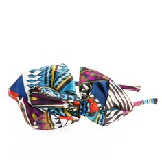 Tribal prints, bold jewel tones, and a sweet bendable side bow anchored by a sapphire crystal cluster make the Lian headband a seasonal trend all-star!
