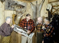 A sportsman shows off a mounted salmon to his friends in New Hampshire, April 1943. (B. Anthony Stewart/National Geographic)