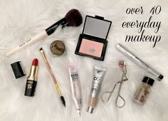 Photo of makeup laid out on. sheepskin rug. An opened compact of blush, tube of lipstick, tubes of concealer and CC cream and mascara. An eyelash curler, a few brushes, a pot of eyebrow color and jar of eyelid concealer.