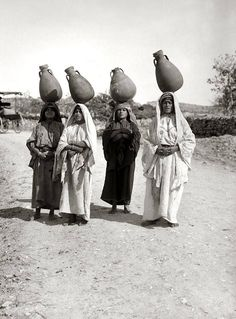 Village women carrying water.