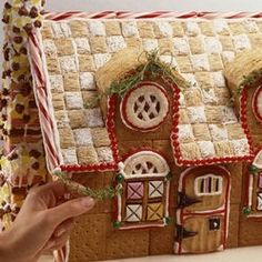 gingerbread houses with thatched frosted mini wheats roof. Always use those, but love the checkered look! Decorating a gingerbread house is the ultimate holiday baking activity. Take these edible Christmastime homes to the next level with cute ideas. Gingerbread House Pictures, Cool Gingerbread Houses, Gingerbread House Parties, Gingerbread Decorations, Christmas Gingerbread House, Noel Christmas, Christmas Goodies, Christmas Baking, Gingerbread Cookies