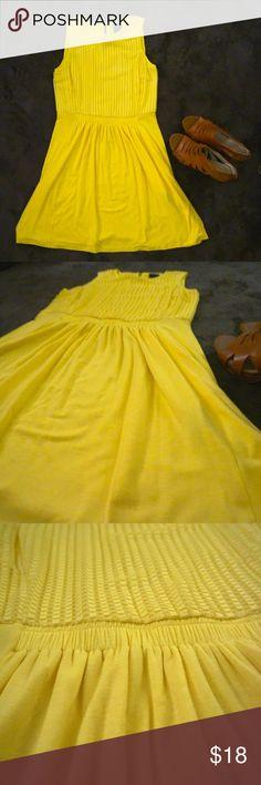 Gabby Skye Yellow Sundress Gabby Skye Yellow Sundress. Size 10. Elastic sinch waist, monotone textured to. Small keyhole in back. Knee length. Like new. Gabby Skye Dresses