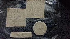 Hand made clay coasters : make dough, trace design, let it dry ;)