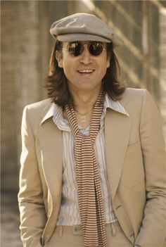 John Lennon in NYC 1975. Sporting better fashion sense then most did in the 70's!