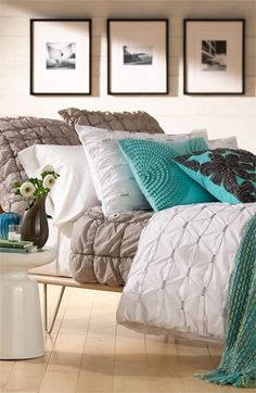 Pretty neutrals and teals in the bedroom.