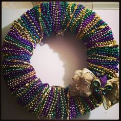 beads wreath pinterest | My Mardi Grad wreath I made out of old beads and recycled parts. Got ...
