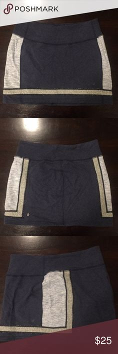 Lululemon casual sweatpant skirt Casual and cute skirt, heathers navy blue with a heathered blue side stripe and heathered grey bottom stripe. Perfect with a white cotton v-neck in the summer, flat stitching and low rise waistband with a small pocket. Good condition and very functional!!! lululemon athletica Skirts Midi