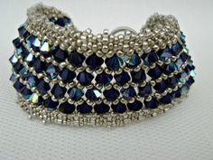 Blue and silver beaded bracelet with Swarovski elements in metallic indigo. Seed bead jewelry.