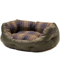 """The Barbour 24"""" Quilted Dog Bed offers your much loved pet the warmth and comfort they need, filled with luxurious padding offer them superior comfort. This quilted dog bed boasts Barbour style featuring the signature box quilt, finished with the Barbour Classic Tartan lining. For added comfort for your canine companion the high walls keep them secure and cosy, while the drop down front offers easy access. The cushion pad is removable and washable for your convenience."""