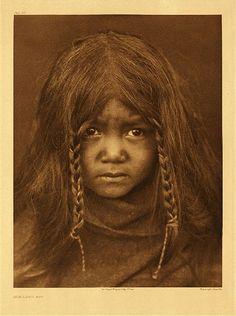 Quilcene boy in a photo taken by Edward Curtis in 1912.